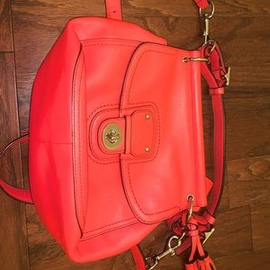 Gently used coral Coach purse.